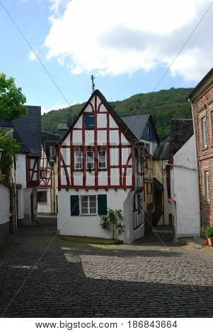 old historic cobbled streetand woodframed house in Ediger Mosel Germany