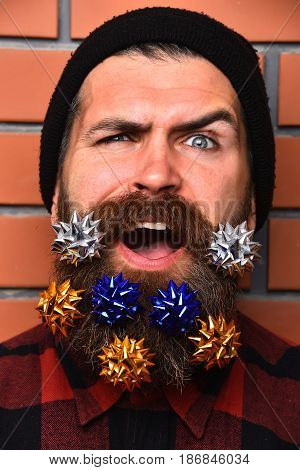 Bearded Man, Brutal Caucasian Squinting Hipster With Gift Decorative Stars