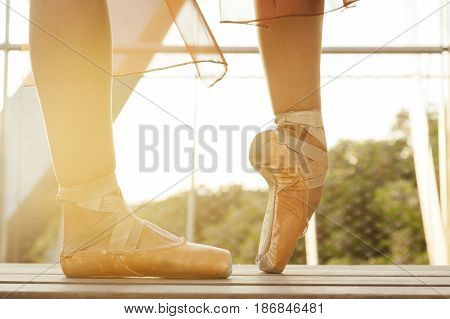 old classic ballerina shoes with a tip pose at dawn