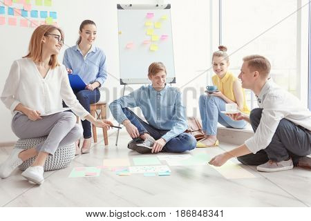 Team of young marketing managers discussing new project in office