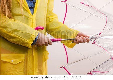 Woman Wearing Waterproof Coat Opening Umbrella