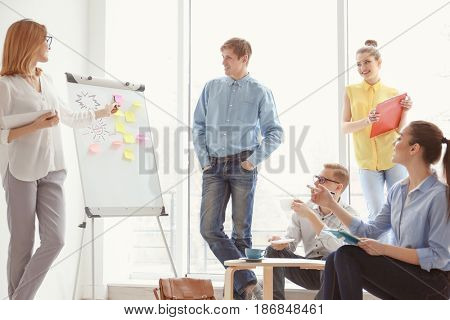 Young woman making presentation in office