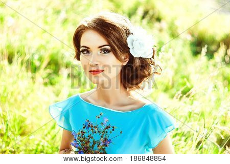 Woman in a forest in a blue dress