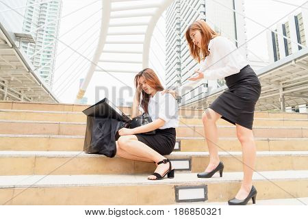 Stressed businesswoman after being dismissed with a colleague clam her down - fired from jobs concept