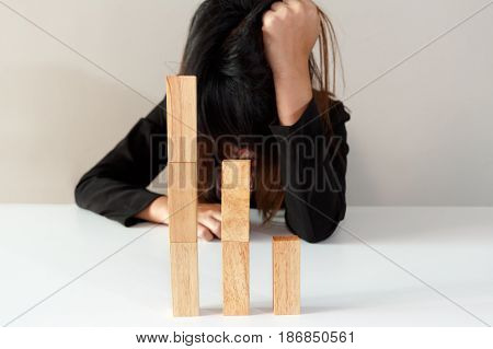 Stressed or sad businesswoman with simulate stock market took a nosedive.