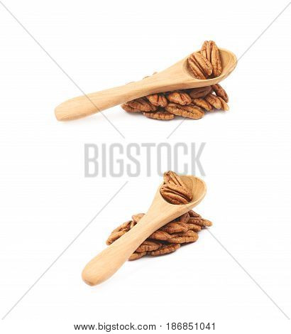 Pile of pecan nuts with the wooden spoon over it, composition isolated over the white background, set of two different foreshortenings