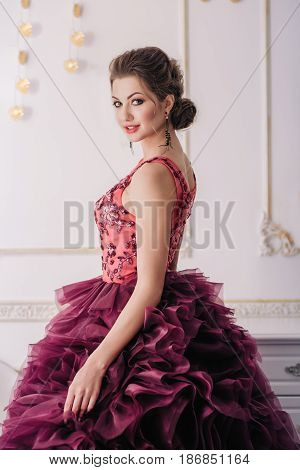 Bride in a luxury apartment in a wedding dress.