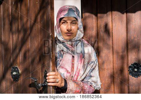 Muslim woman at mosque door