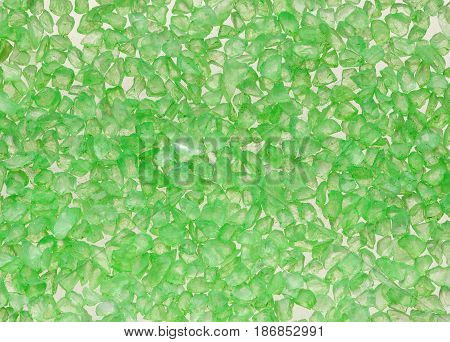 Macro background from green translucent crystals. Texture of small stones.