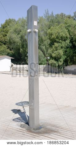 shower post on beach in Spanish village
