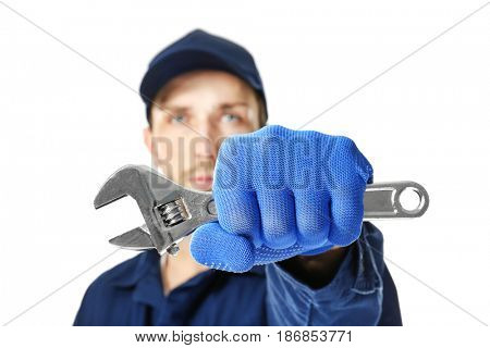 Auto mechanic with wrench on white background, closeup