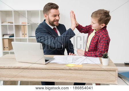 White Collar Worker With Son At Office