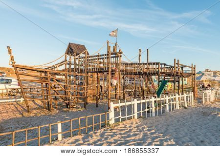 LANGEBAAN SOUTH AFRICA - APRIL 1 2017: Sunset at a playpark on a beach at Mykonos in Langebaan a town on the Atlantic Coast of the Western Cape Province