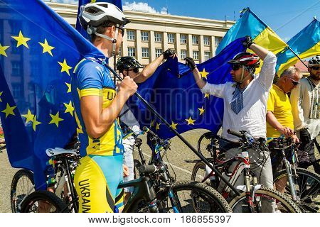 Uzhgorod Ukraine - May 17 2017: The participants of the cycling Euromarathon unfold the EU flag on the day of signing the legislative act on visa-free regime between Ukraine and the European Union.