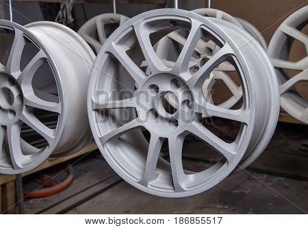 Powder coating of auto wheels in workshop