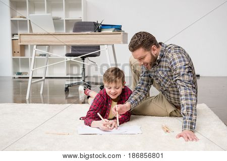Businessman Freelancer Drawing With Son At Home Office