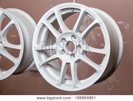 Drying of auto wheels after powder coating in workshop