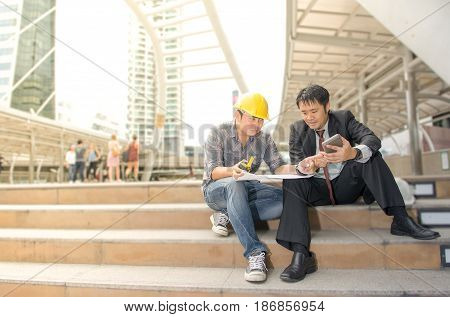Asia leader and worker are work together in the city
