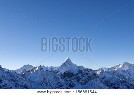 Beautiful Ama Dablam Peak Lit By The First Rays Of Morning Sun. Sharp Mountain Peak Standing Out Amo