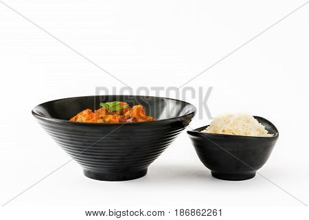 Chicken tikka masala and rice in bowl isolated on white background