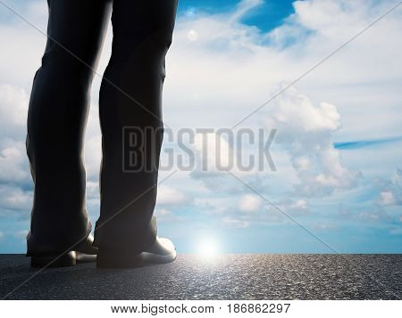 rear view of businessman standing with blue sky background. 3d rendered