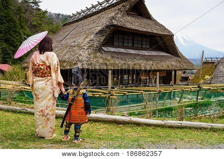 Samurai Child And Mother In Old Village