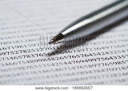 Numbers, pen focus data finance reviewing financial figures