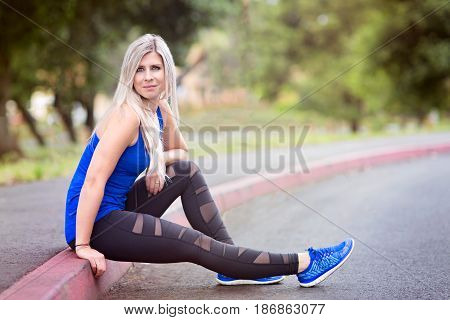 portrait of young attractive woman outdoor after fitness exercise healthy lifestyle concept