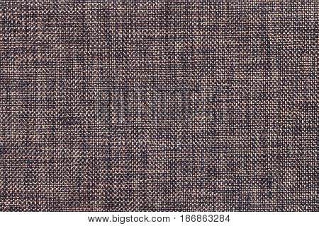Dark brown and black background of dense woven bagging fabric closeup. Structure of the umber cloth with natural texture. Cloth backdrop.