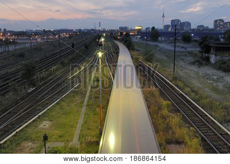 view over railways with skyline of berlin