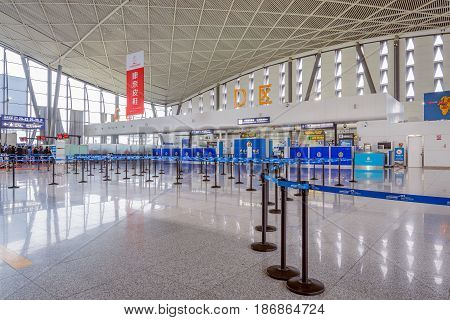 Urumqi China October 28 2016: The public check-in area with crowd control barriers of the city airport at early morning time.
