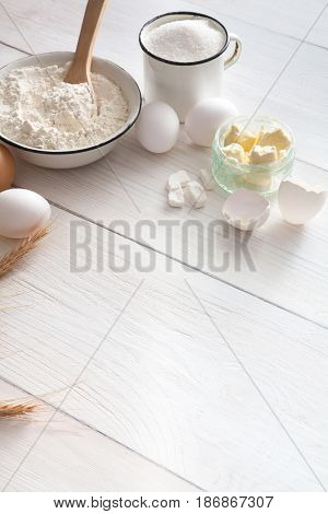 Baking background with copy space. Cooking ingredients for yeast dough and pastry