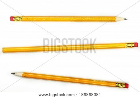 Pencil writing instrument writing utensil drawing tool eraser isolated on white sharpened