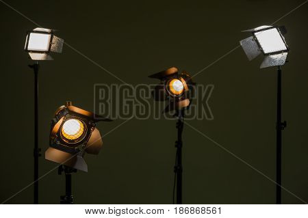 Halogen and led lights. Spotlights with Fresnel lenses. Studio photography. Photo and video shooting.