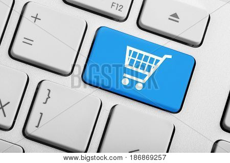 Netbook notebook computer key computer shopping trolley close up button