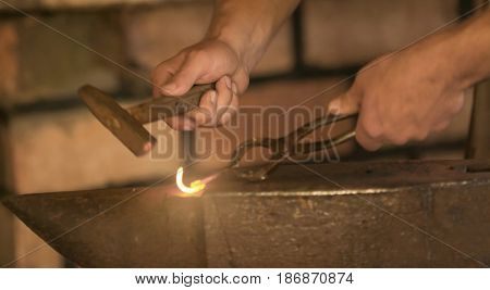 Smith working with iron in the forge