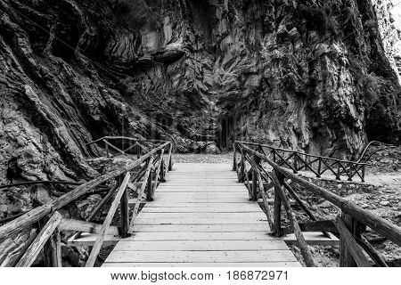 Samaria Gorge. Wooden decking for the transition across the river. Island of Crete. Greece. lack and white.