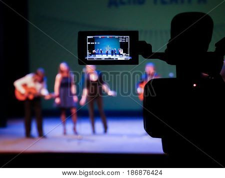Shooting concert video. Control monitor. Blurred background, bokeh. Videography.