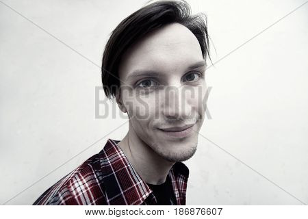 Portrait of strange man indoors. Horizontal photo