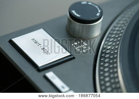 Turntable gramophone stop button close up start focus on foreground