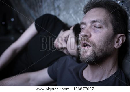 Killing ourselves slowly. Stoned frustrated heroin addicted couple sitting on the street while feeling exhausted and having delusion after drug dose