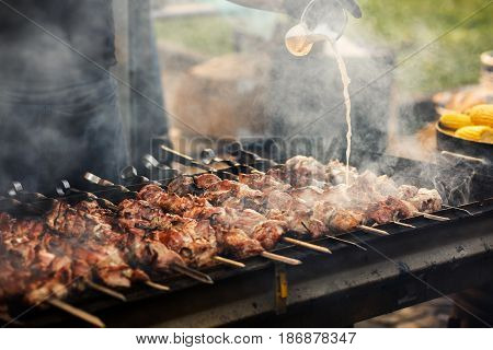 Delicious Bbq Kebab Grilling On Open Grill, Outdoor Kitchen. Food Festival In City. Tasty Food Roast