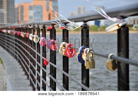 Kazan, Tatarstan, Russia - May 16, 2017. Kazan, Tatarstan, Russia - May 16, 2017.Padlocks of lovers on the railing of the embankment near the center of the family