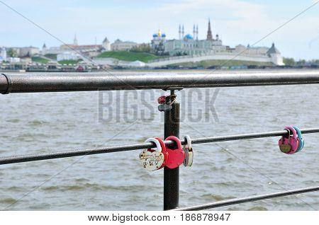 Kazan, Tatarstan, Russia - May 16, 2017. Padlocks of lovers on the railing of the embankment near the center of the family