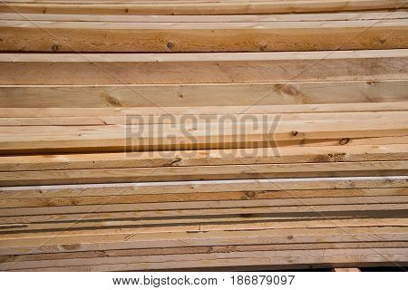 Lumber, timber, natural wood boards and beams