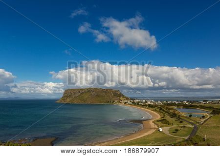 View of the Nut, old volcanic plug of basalt with the height of 143 meters rising from the ocean, and Stanley town, small port. View from Highfield lookout, Tasmania Australia