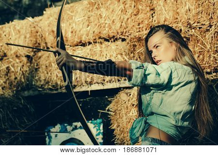 Girl Archer Shooting With Bow And Arrow