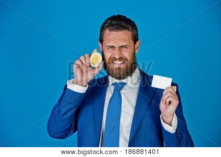 Man With Sour Lemon Fruit, Holding Business Or Credit Card
