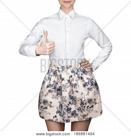 Girl in skirt and a white blouse shows thumb up,  white shirt on isolated white background