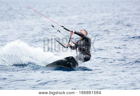 A kite surfer try to ride the waves